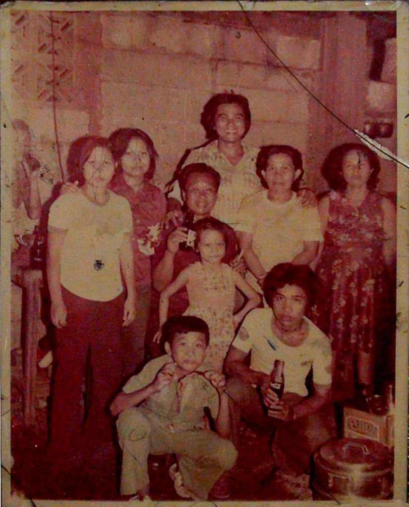 """The Carin Family in Cebu. Vincent """"Inting"""" Carin sitting in the center with Alfredo behind him and Jun in the foreground"""